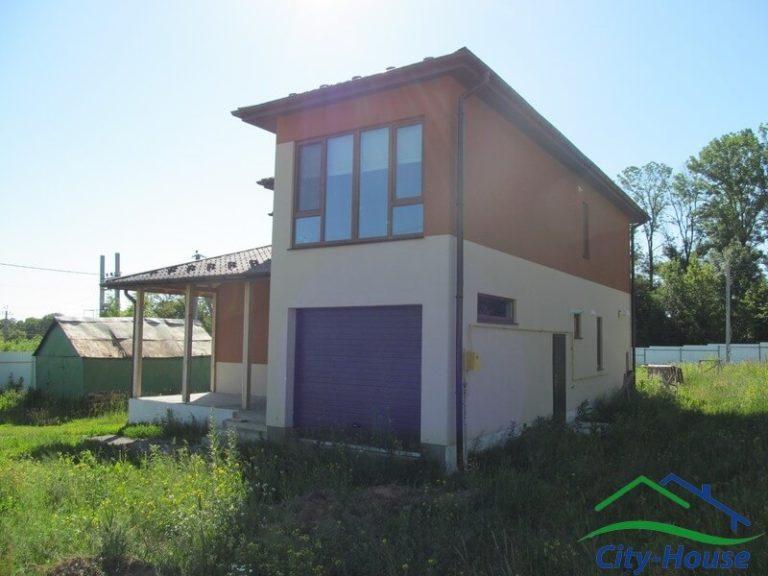 Готовый каркасный дом из СИП панелей с гаражом