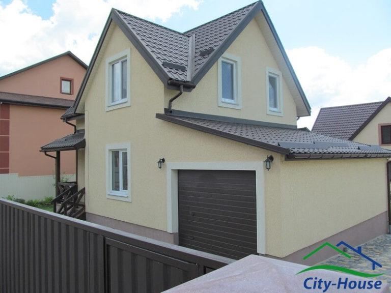 Каркасный дом из СИП панелей с гаражом для автомобиля