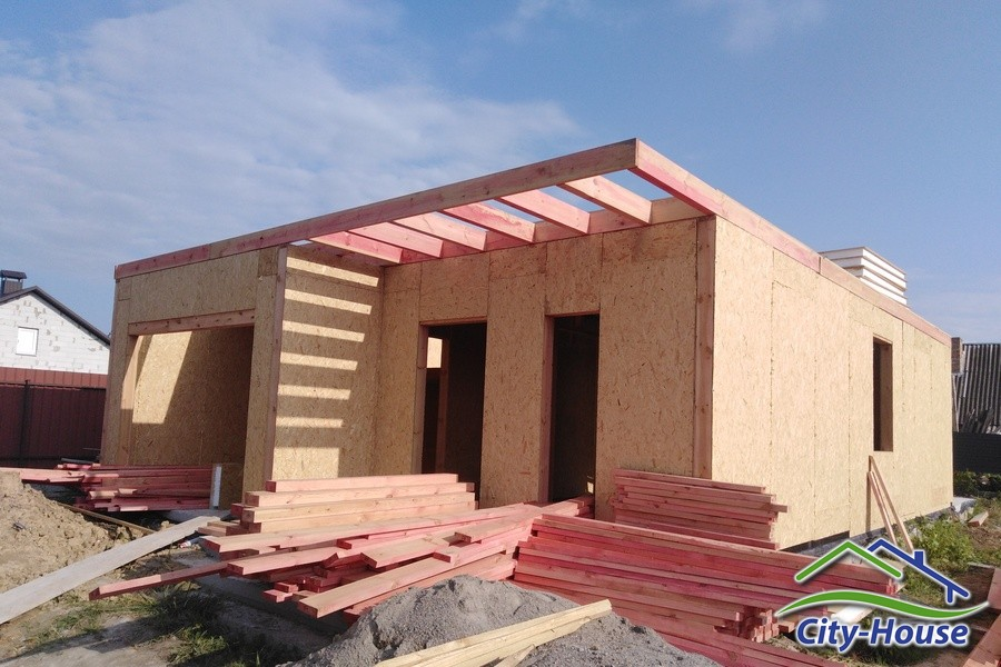 Двухэтажный дом с гаражом из СИП панелей