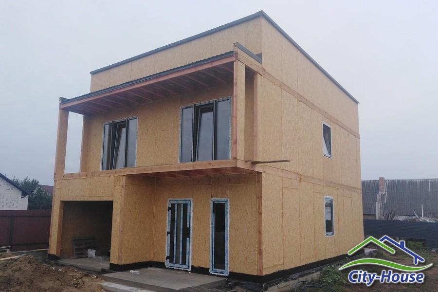 Двухэтажный энергоэффективный дом с гаражом